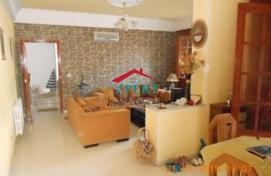 une villa sur deux étages isolée avec jardin et trois studios à Bouhssina